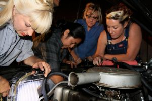rockabilly girl mechanics wrench on classic cars